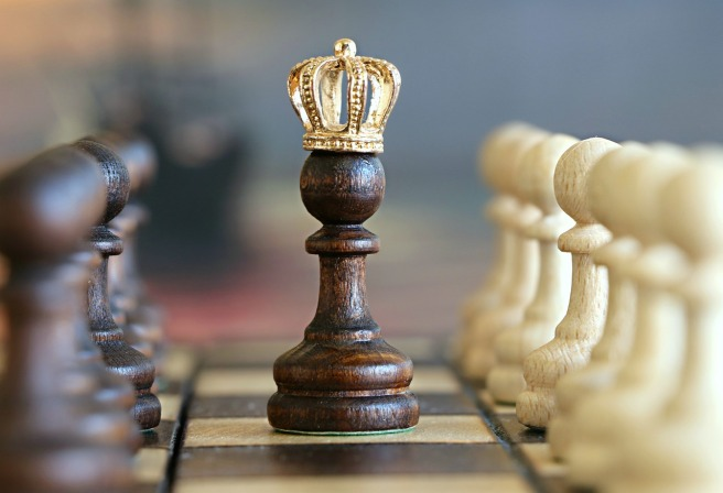 A chess piece wearing a golden crown